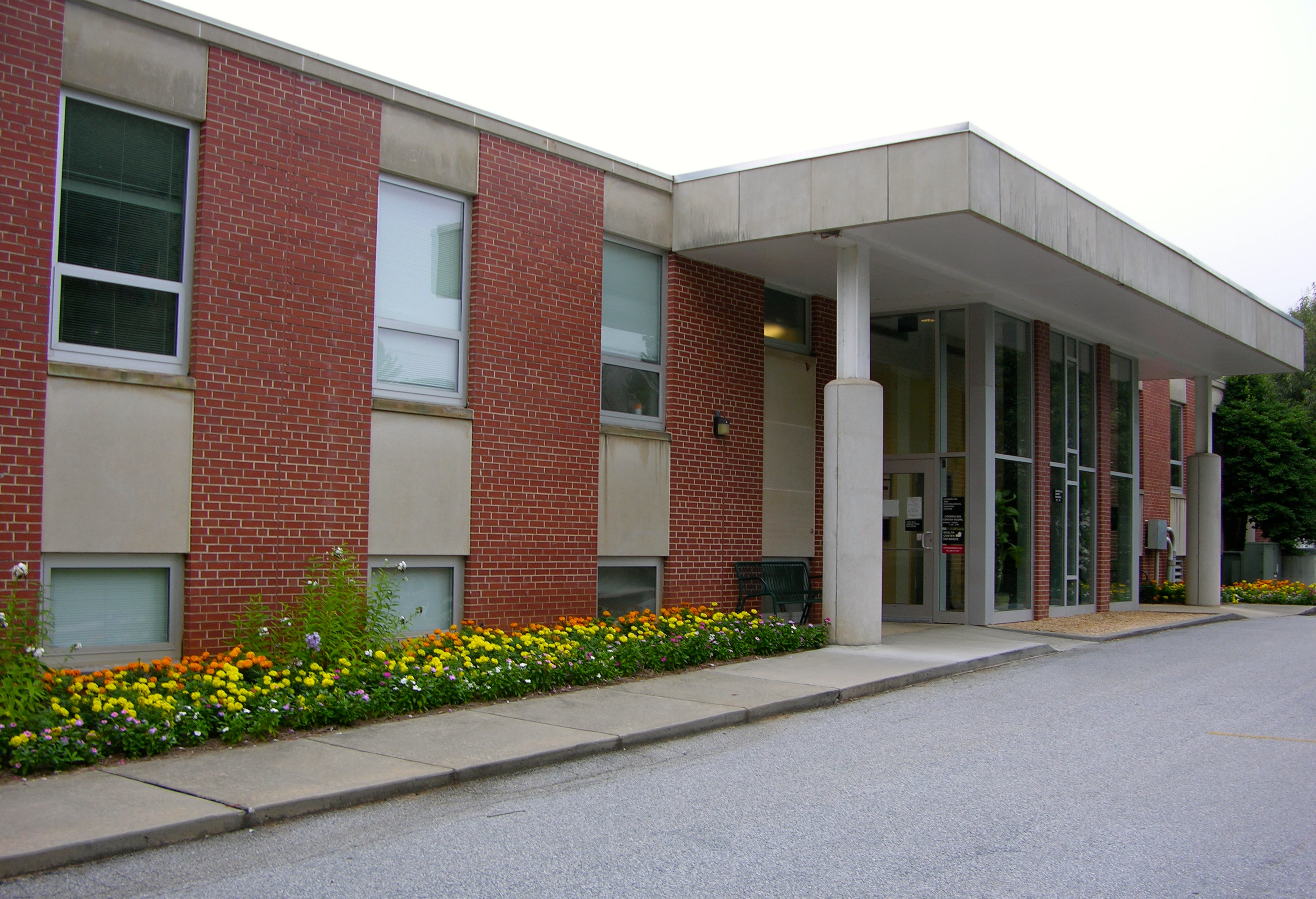 An image of the back of the Health and Wellness building on Campus