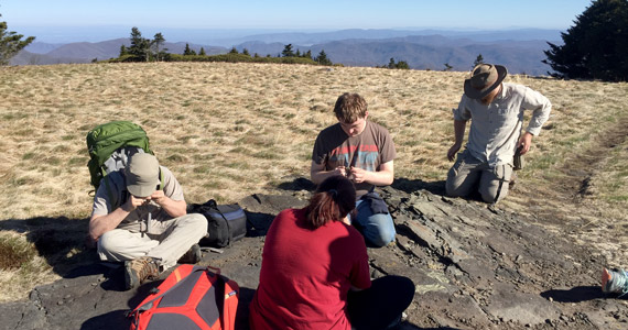 geology students on a mountain top