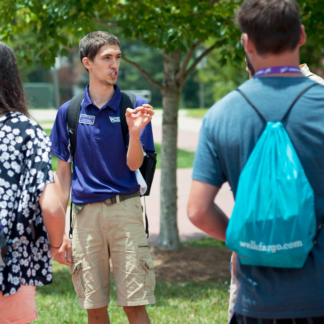 Student working as Orientation Counselor on campus